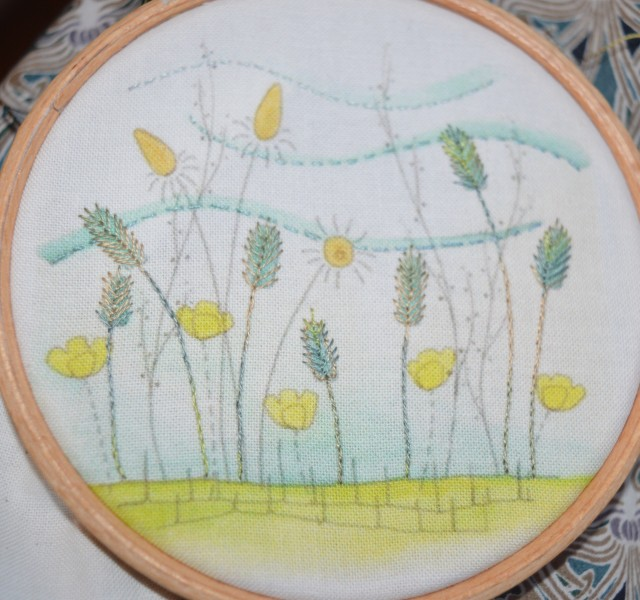 Embroidered filed of flowers