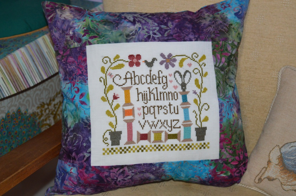 Sewing room cushion; www.thecraftycreek.com