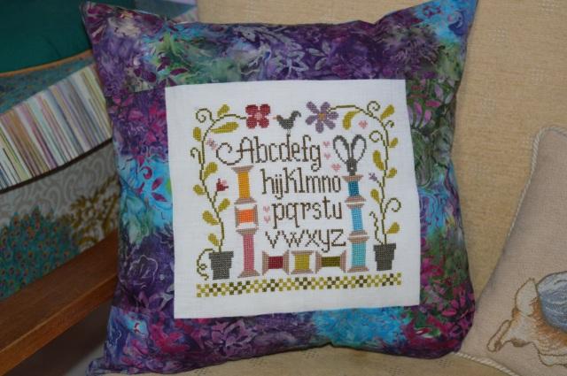 Sewing room cushion; www.thecraftycreek.com